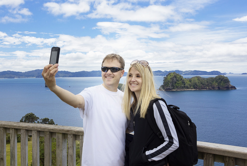 Couple taking selfie over tourist point