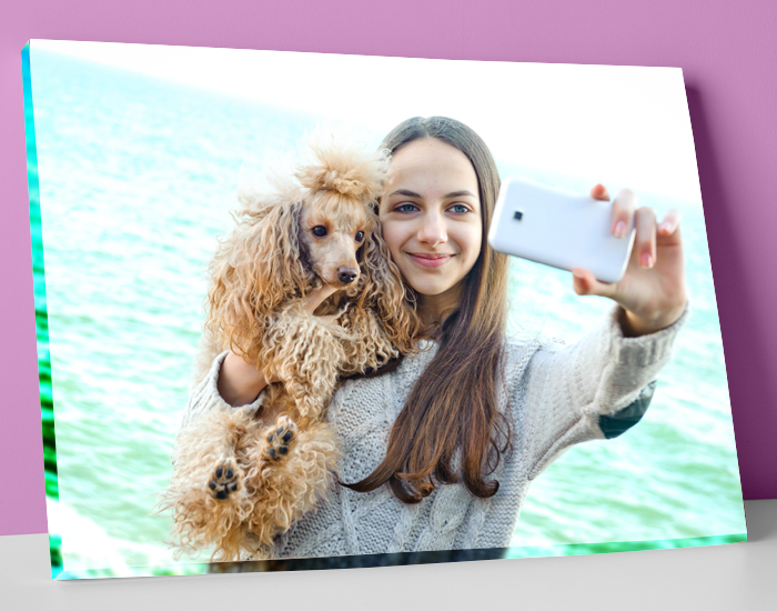 Girl taking selfie with her pet printed on canvas