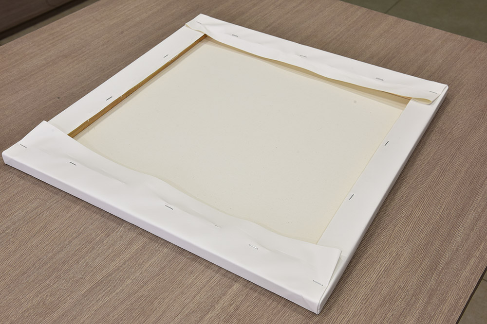 folded corners of canvas