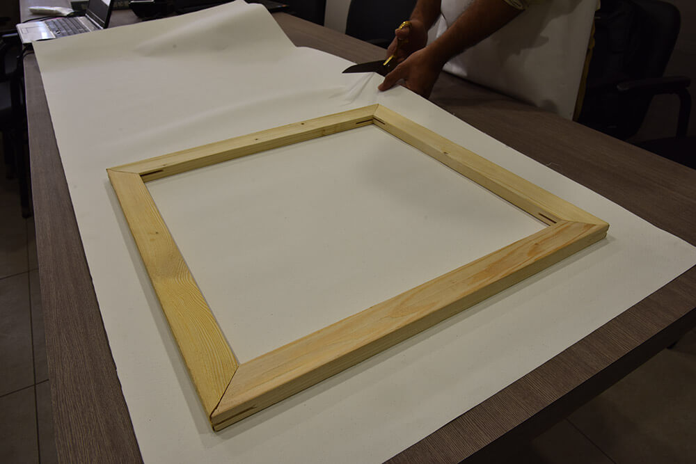 Measure canvas for stretcher bars